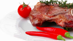 Savory : roasted beef spare rib on white dish with pepper and to Stock Footage