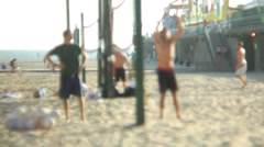 People play volleyball at beach Stock Footage