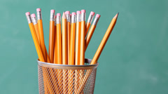 Back to School - desk, pencils and board Stock Footage