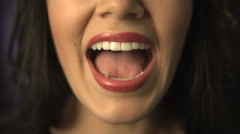 Close up of woman shouting or singing - stock footage