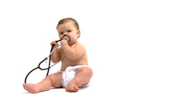 Baby playing with stethoscope - stock footage