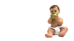 Baby eating an apple Stock Footage