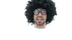 Close up of man in wig and glasses against white background Stock Footage