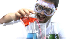 Mad scientist playing with beakers against white background - stock footage