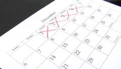 Close up of calendar with days being checked off Stock Footage