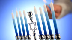 Lighting a Menorah Stock Footage