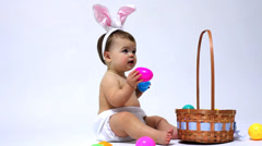 Easter baby against white background Stock Footage
