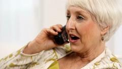 Senior woman talking on telephone - stock footage