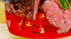 Grilled barbecue on red dish Stock Footage