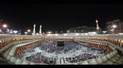 Muslim pilgrims circumambulate the Kaaba in Makkah, Saudi Arabia. Stock Footage