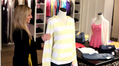 Woman fits manikin with clothing Stock Footage