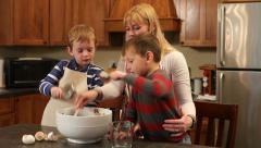 Stock Video Footage of Children helping Mom in kitchen