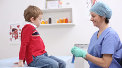 Young boy getting medical checkup - stock footage