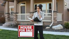 Realtor in front of a house Stock Footage