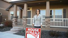 Realtor in front of a house - stock footage