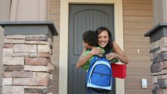 Mother welcomes her son home from school - stock footage