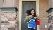 Stock Video Footage of Mother welcomes her son home from school