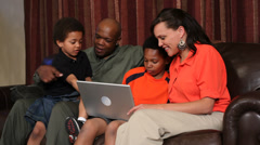 Portrait of African American family using laptop Stock Footage