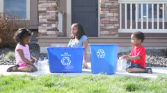Portrait of African American children recycling Stock Footage