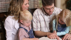 Family reading together Stock Footage