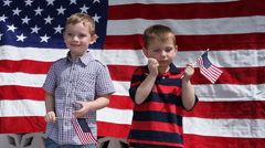 Young boys waving American flags - stock footage