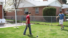 Family or friends playing in the garden Stock Footage