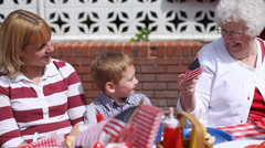 Great Grandma gives young boy flag Stock Footage