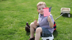 Young boy waving American flag Stock Footage