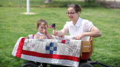 Mother and daughter waving American flag - stock footage