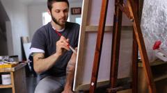 Artist painting in studio Stock Footage
