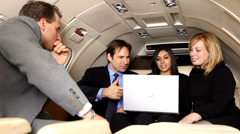 Businesspeople have meeting in corporate jet Stock Footage