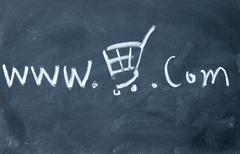 Online store symbol drawn with chalk on blackboard Stock Photos