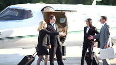 Business team walks off jet Stock Footage