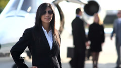 Confident businesswoman outside jet Stock Footage