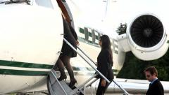 Businesspeople board corporate jet Stock Footage
