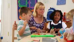 Preschool teacher and kids Stock Footage