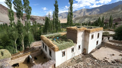 Local women working on farmhouse roof, Ladakh, India                             Stock Footage