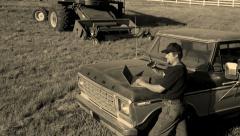 Farmer using laptop computer - stock footage