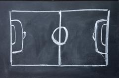 Abstract football field drawn with chalk on blackboard Stock Photos
