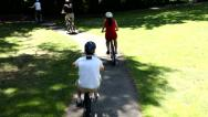 Family riding bicycles together Stock Footage