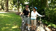 Family walking bicycles together Stock Footage
