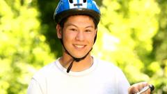 Portriat of teen with bicycle Stock Footage