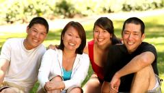Portrait of Asian family in outdoor setting - stock footage