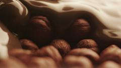 Real Liquid Chocolate Covers Hazelnuts Stock Footage