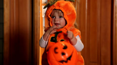 Young girl in Pumpkin costume Stock Footage