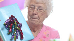 Senior woman with birthday present Stock Footage