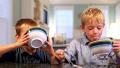 Two young boys eating ice cream Stock Footage