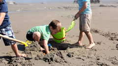 Boys playing on the beach Stock Footage