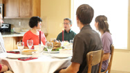 Stock Video Footage of Family prays at Thanksgiving diner