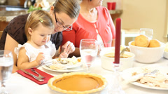 Family eat Thanksgiving dinner - stock footage